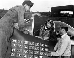 """Col. Francis Gabreski (28 Kills. POW 20.07.1944), 61st FS, 56th FG, 8th U.S.A.A.F., in his P-47D """"Thunderbolt"""" HV-A, talk with S/Sgt. R. Safford and Cpl. F. Schacki after your last kill, a Bf 109G-6 over Évreux, France. RAF Boxted, Essex, UK. 5 July 1944. 