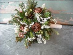 Bridal bouquet made with fresh evergreens and pine cones with birch handle. For your winter woodland natural wedding.. $59.00, via Etsy.