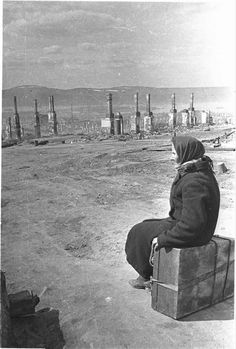 An elderly Russian woman rendered homeless by the near destruction of Murmansk sits upon her suitcase and ponders where to go. The Germans launched an offensive against the city in 1941 as part of. World History, World War Ii, Soviet Union, Military History, Old Photos, Vintage Photos, Historical Photos, Where To Go, Wwii