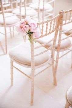 Chiavari chairs & clusters of beautiful blooms create an easy decor idea for the ceremony.