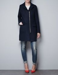 Black coat and a pop of red pointed heels