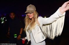 Funky: She danced her way into the VIP area wearing a light suede baseball cap ...