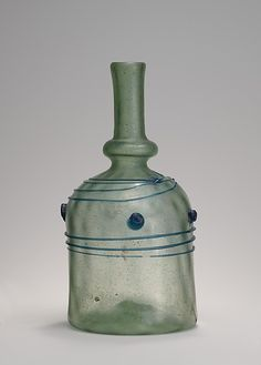 An Anglo- Saxon glass bottle, found in Faversham, Kent, King's Field Cemetery. Many wonderful things were found when the railways were being built in the 1860's, this being one along with 20 gold brooches it would have been maybe the largest Anglo-Saxon find, but became a Victorian free for all, and the finds were not recorded properly and scattered.