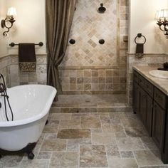 Bathroom. Traditional Interior Bathroom Design Ideas. Traditional Beige Bathroom Idea Feature Freestanding White Oval Bathroom Tub And Wall Mounted Wooden Chocolate Countertop Top Granite Bathroom Vanity Undermount Sink And Wall Mounted Bronze Double Towel Racks. Traditional Bathroom Design Ideas