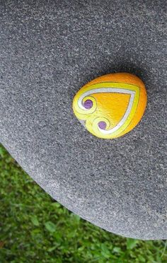 A gorgeous yellow heart shaped hand painted stone painted during my 365 days project in 2011. A blessing stone... to see the full story of this stone click on the image.