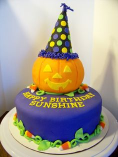 """Party Hat Pumpkin: White cake/chocolate butter cream icing. Jack-o-lantern is rkt covered in fondant. """"Real"""" candy corn."""