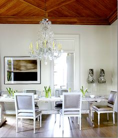 In New Orleans, Ann Holden used antique Louis XVI chairs with a metallic gray leather.