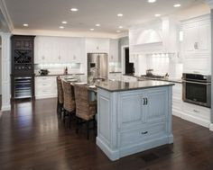 more white kitchen with pale blue island