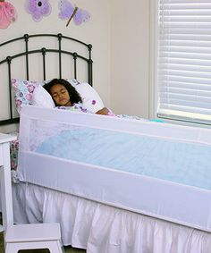 This brilliant bed rail is simple to set up and swings down and out of the way when it's time to crawl under the covers or make the bed. An extra-long length, tall height and durable, sturdy design make this piece perfect for preventing restless sleepers from tumbling out of bed, while a patented Gap Guard feature stops children from sliding between the mattress and bed rail. With no tools required for setup, this clever contraption is a breeze to assemble and fits up to a queen-size bed…