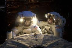 Astronauts John Grunsfeld (left) and Andrew Feustel perform repairs on the Hubble telescope during one of many periods of darkness in the final seven-hour space walk.