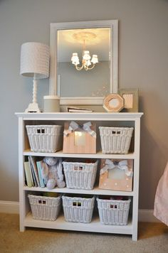 Sweet peach....it's a girly room with soft gray walls, white linen, and peach accents. It was a DIY project and a labor of love for the entire family...my husband and I hand painted all the furniture (except crib), and I handmade the chandelier and mobile.  My 13 year old daughter and I made the photo frames and other accessories.