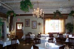 Main Street Cafe. Old Madison City Hall and jail, built in 1955. Homemade daily specials, pasta, sandwiches, salads, casseroles, rolls and desserts. Lunch Monday- Saturday 11 a.m. - 2 p.m.   101 Main Street  Madison AL 35758  (256) 461-8096