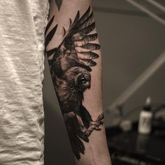 flying owl tattoo on the arm