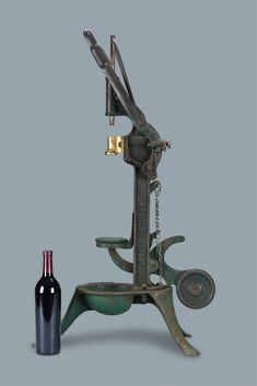This vintage French #wine corker brings the fine art of French winemaking to life. One by one, bottles are placed on the elevated platform. With a crank of the lever, a weighted plunger descends to insert the cork. Crafted of cast-iron, this would be a perfect addition to any wine enthusiast's collection ~ M.S. Rau Antiques