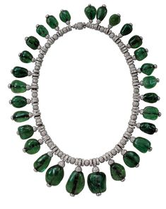 A Cartier cabochon emerald and diamond necklace, commissioned by Merle Oberon in 1938 - part of the Denver Art Museum's Brilliant: Cartier in the 20th Century exhibition, which runs until 15 March 2015. © Cartier