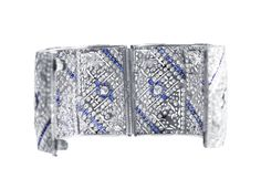 Art Deco Sapphire Diamond Platinum Floral and Geometric Design Bracelet   From a unique collection of vintage bangles at https://www.1stdibs.com/jewelry/bracelets/bangles/