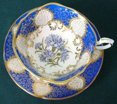 Vintage Paragon Fine Bone China Quatrefoil Tea Cup And Saucer In Royal Blue by Divonsir Borges