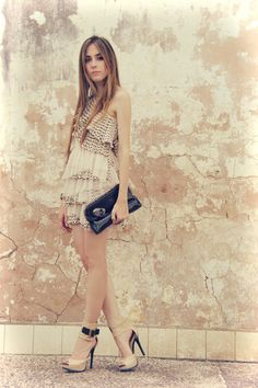 girly dress with tough clutch