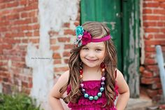 Photography, door, standing, pose, 4 year old, 4th birthday, four, headband, chunky necklace, teal, magenta, green, old door, brick, so cute, kid, girl, kid pose, girl pose, 4 year old pose, hands on hips, city, downtown, alley, Eta Fe Photography