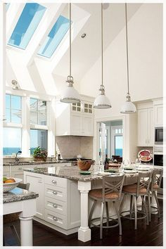 White kitchen cabinets, dark wood floors, vaulted ceilings with skylights, granite countertops, large kitchen island. home decor and interior decorating ideas. lake home. White Kitchen Interior, White Kitchen Cabinets, Interior Design Kitchen, Kitchen White, Country Kitchen, Kitchen Designs, Kitchen Drawers, Aqua Kitchen, Floors Kitchen