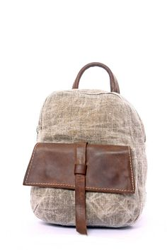 This small gray backpack is cute and stylish Handmade by me from genuine Italian leather and strong canvas. This rucksack has 5 separate compartment and is large enough to fit several notebooks, iPad and stationary or supplies for a day trip. The front flap closes securely with two strong
