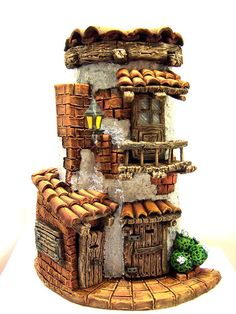 suspishuslee like a Goblin house. How about several of these for a Goblin City in my Labyrinth guest room! Clay Houses, Ceramic Houses, Miniature Houses, Tile Crafts, Clay Crafts, Diy And Crafts, Clay Fairy House, Fairy Garden Houses, Clay Fairies