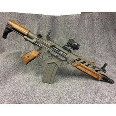 Nice AR with zebra wood hand rail, stock and grip!