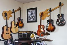 Hang multiple guitars with style! Wall-Axe Custom Guitar Hangers keep your guitars safe and add serious class to your living room, man-cave, or home studio.  Starting at only $69. www.WallAxe.com