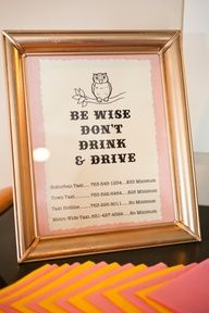 """A great idea if alcohol is being served at your wedding: a framed """"Don't Drink & Drive"""" sign with local taxi numbers."""