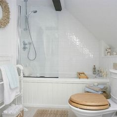 small bathroom with sloped ceiling by leeann.hall.16