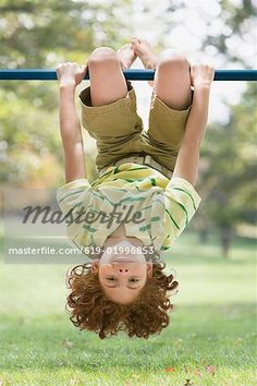 Mixed Race boy hanging upside down – Image © Masterfile.com: Creative Stock Photos, Vectors and Illustrations for Web, Mobile and Print