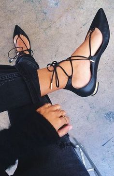 Black lace up flat.