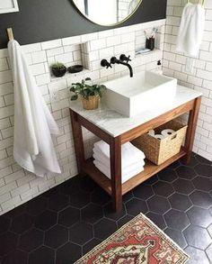 marble vanity and black hex tile