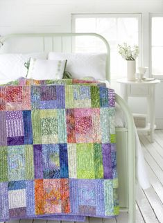 Splashes of Color Use batiks in this quick-to-sew bed-size quilt—or not! Delicious sherbet-tone batiks are its foundation, but designer Tammy Kelly has added pretty coordinating prints that fit right in for a softer touch. Start with a simple square, surround it with four mix-and-match rectangles, and voilà—one block is done. Make a block or two each day, and soon you'll have enough for the stunning, borderless quilt top (no borders to cut and add puts another fast twist on this project).
