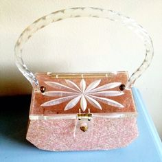Pink lucite purse. Cute as!