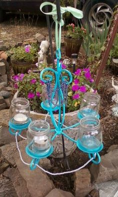 i repurposed this candle holder into an outdoor chandelier. i attached baby food jars and added tea light candles :)  johnna