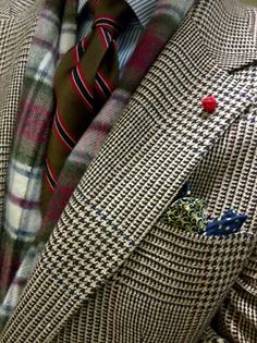 Houndstooth jacket, white shirt with blue dress stipes, green tie with stripes
