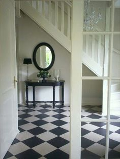 large entry, European style floor, french doors