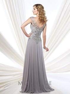 Montage by Mon Cheri - 215914 - Chiffon, tulle, and lace A-line gown with hand-beaded lace illusion cap sleeves and front and back V-necklines, gathered skirt, sweep train. Matching shawl included.  Sizes: 4 - 20, 16W - 26W  Colors: Silver, Dark Champagne