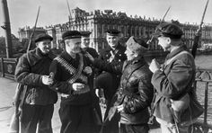 Militia/workers of the Kirov Factory and Soviet naval infantrymen on a bridge near the factory, Leningrad, Russia, 1 Apr 1942
