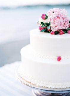White cake topped with pink peonies | Photo by Caroline Tran