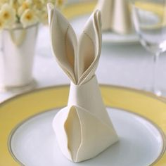 Bunny fold napkins from Martha of course.  http://www.marthastewart.com/how-to/bunny-fold%20for-napkins?lnc=ad80e3c2fd17f110VgnVCM1000003d370a0aRCRD