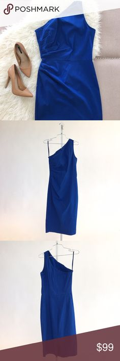 One Shoulder Royal Blue Fitted 'Ava' Dress Amazing royal blue dress made of stretch nylon bengaline from Features a single shoulder strap, asymmetrical neckline, a back kick pleat, and back zip closure. Hemline falls below the knee. The pleats on the side make this body con dress super flattering. I got so many compliments the two times I wore it. Please carefully review each photo before purchase as they are the best descriptors of the item. My price is firm. No trades. First come, first…