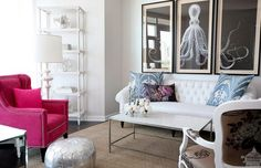 "A mostly white living room with touches of silver, blue and the smack of pinky fuchsia of the armchair. There's a bit of the fuchsia in the pillow on the couch, but I think it needs a bit more somewhere else in the room to feel more cohesive.  From ""The Cross Decor & Design."""