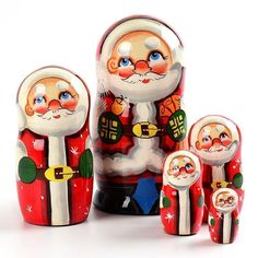 "5 Piece Santa Nesting Doll - $49.99 Santa Claus is coming to town in a very unique way... on an authentic Russian nesting doll! This 6"" x 3"" handmade wooden doll was painted with vibrant colors before being gloss finished. It has 5 dolls (or 5 Santa Clauses) total. What an interesting Christmas gift! Happy Holidays from Russia with love."
