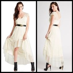 ‼️COMING SOON‼️ROMANTIC HI/LO MAXI DRESS BY GUESS This is a stunning hi/lo dress by guess. There are tiny Swiss dots all over.  The V-neck goes from front to back. Such a romantic and feminine item. Take it from casual to dressy. BELT IS INCLUDED Guess Dresses High Low