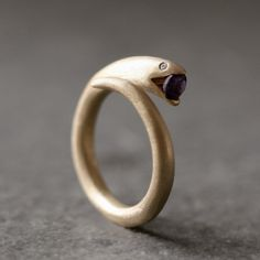 Snake ring with amethyst and tiny diamond eyes -- brass -- ooo!