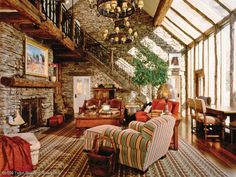 Love the rock, reclaimed wood and iron staircase and those windows!