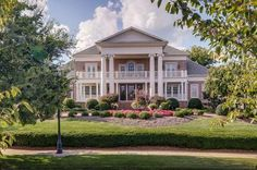 Magnificent colonial with brick stairway and porch flanked by 12 massive corinthian columns that overlooks the roundabout with obelisk statue and gardens!