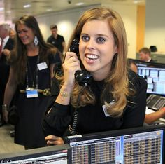 9/11/14.   Princess Beatrice, 26, looks overjoyed to be helping out at the annual banking fundraiser